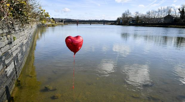 A red balloon in the River Teifi in Cardigan, Wales, near the scene where two-year-old Kiara Moore was recovered from a car that had plunged into the river (Ben Birchall/PA)