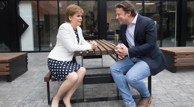 Jamie Oliver meeting First Minister Nicola Sturgeon at Benwell House in London (Stefan Rousseau/PA)