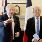 Boris Johnson meets French foreign minister Jean-Yves Le Drian for talks (Kirsty O'Connor/PA)