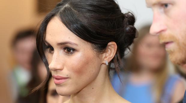 Meghan Markle is reported to be trying to persuade her father to accompany her in St George's Chapel on her big day (PA)