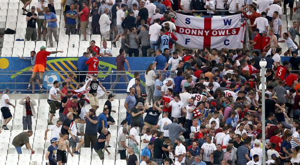 Tempers flare between rival fans during Euro 2016 (Owen Humphreys/PA)