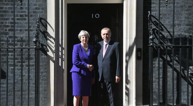 Prime Minister Theresa May greets Turkish president Recep Tayyip Erdogan at Downing Street (Victoria Jones/PA)