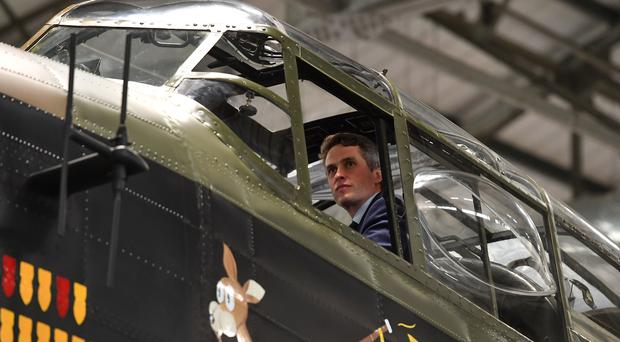 Defence Secretary Gavin Williamson looks out of the cockpit of an Avro Lancaster bomber during a visit to RAF Coningsby (Joe Giddens/PA)