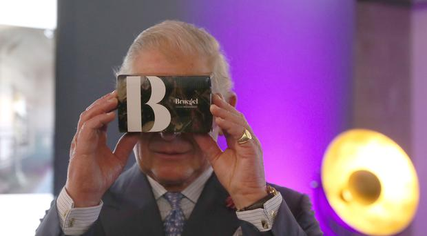 The Prince of Wales looks through a virtual viewer during a visit to the YouTube Space London in King's Cross (Steve Parsons/PA)