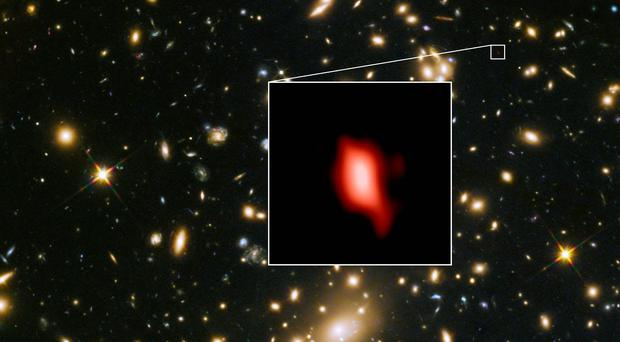 Image of the galaxy cluster MACS J1149.5+2223 (highlighted inset, oxygen distribution shown in red). Light from the galaxy has been travelling across space for 13.28 billion years. (LMA (ESO/NAOJ/NRAO), NASA/ESA Hubble Space Telescope, W. Zheng (JHU), M. Postman (STScI), the CLASH Team, Hashimoto et al/PA)