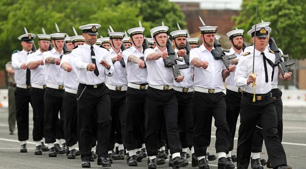 Members of the Royal Navy Small Ships and Diving unit practice on the parade ground at HMS Collingwood in Hampshire, as they prepare for the Royal wedding (Andrew Matthews/PA)