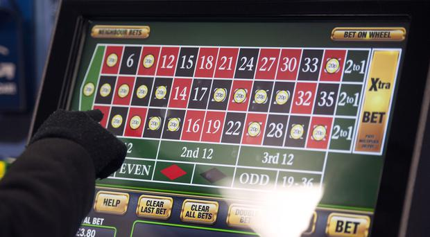 The amount people can stake on fixed-odds betting terminals (FOBTs) will be slashed to £2 to reduce the risk of 'gambling-related harm', the Government has announced (Daniel Hambury/PA)