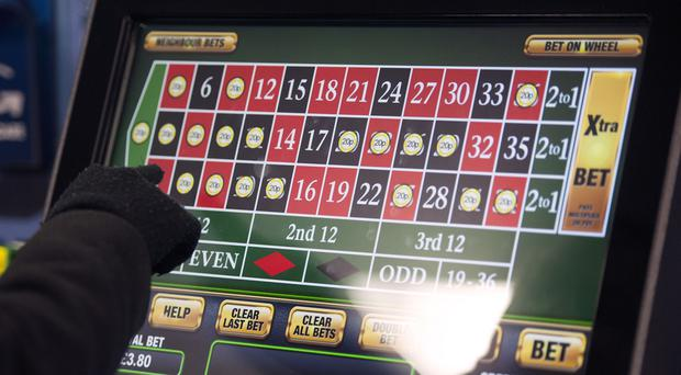 The highest stake on controversial fixed-odds betting machines will be slashed to £2 (Daniel Hambury/PA)