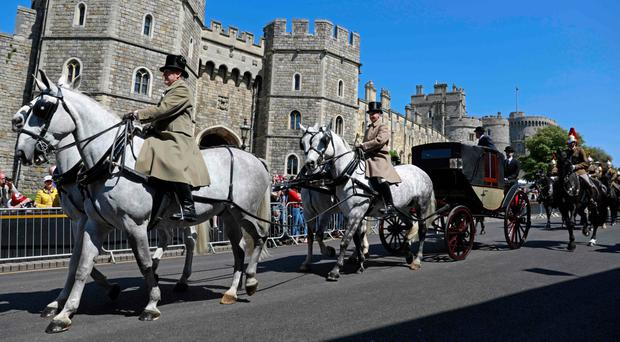 The Ascot Landau carriage pulled by Windsor Grey horses, is taken past the Henry VIII gate during a rehearsal for the wedding procession outside Windsor Castle
