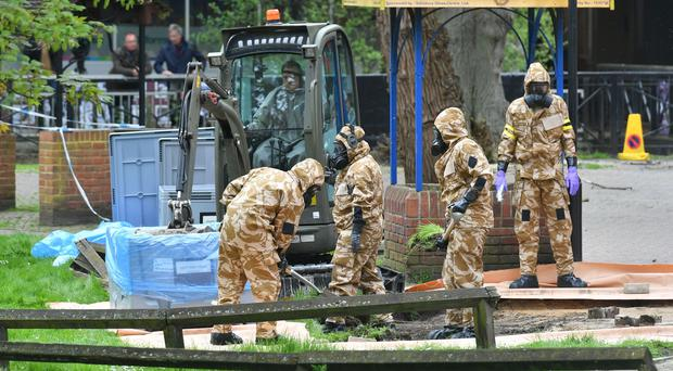 Military personnel at the site near the Maltings in Salisbury where Russian double agent Sergei Skripal and his daughter Yulia were found on a park bench (Ben Birchall/PA)