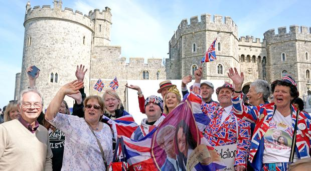 Royal fans outside Windsor Castle ahead of the wedding of Prince Harry and Meghan Markle (Owen Humphreys/PA)