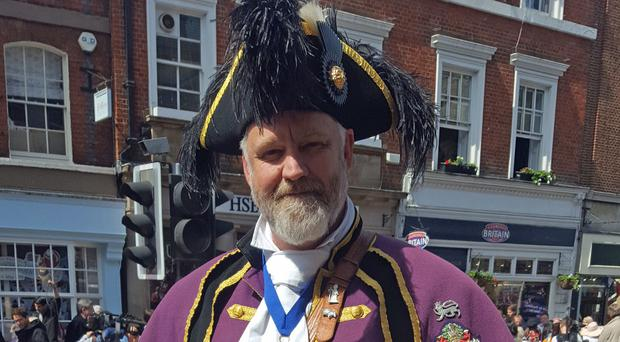 Chris Brown, official town crier of the Royal Borough of Windsor and Maidenhead, on the streets of Windsor (Catherine Wylie/PA)