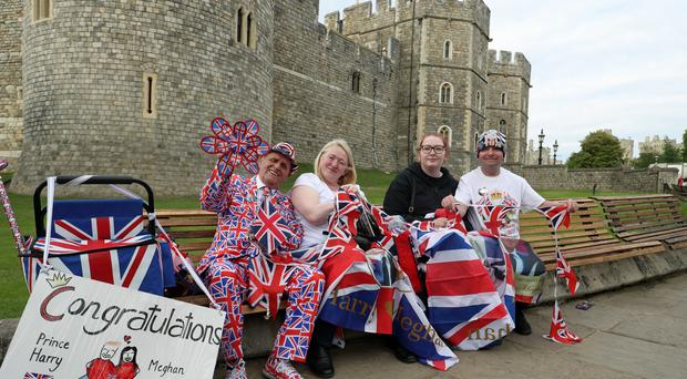 Royal fans (left to right) Terry Hutt, Maria Scott, Amy Thompson and John Loughrey sit on benches outside Windsor Castle (Steve Parsons/PA)
