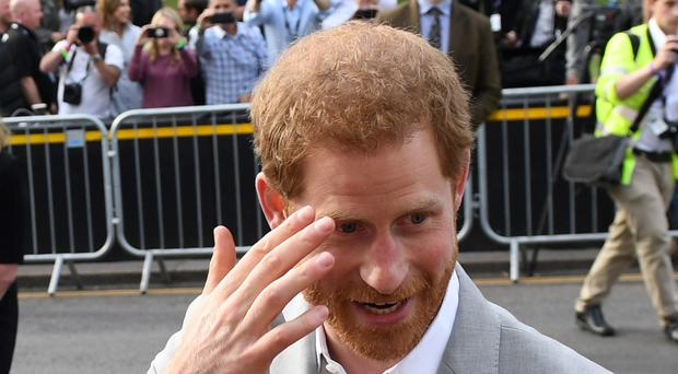 Prince Harry meets members of the public outside Windsor Castle (Simon Hulme/PA)