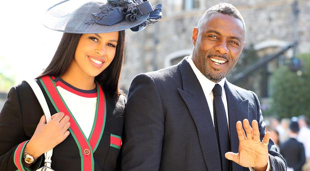 Idris Elba and Sabrina Dhowre arrive at St George's Chapel (Gareth Fuller/PA)