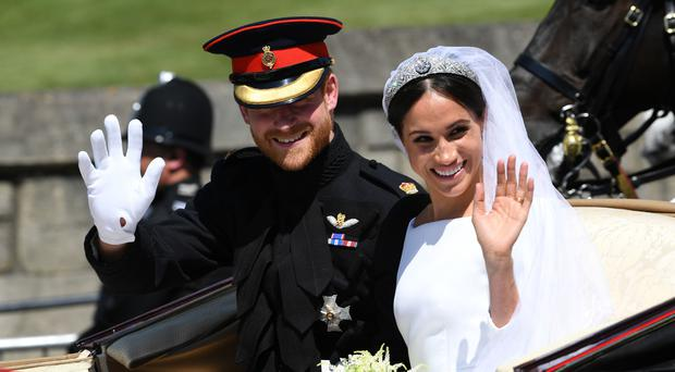 Prince Harry and Meghan Markle ride in an Ascot Landau after their wedding ceremony to Prince Harry at St. George's Chapel in Windsor (Paul Ellis/PA)