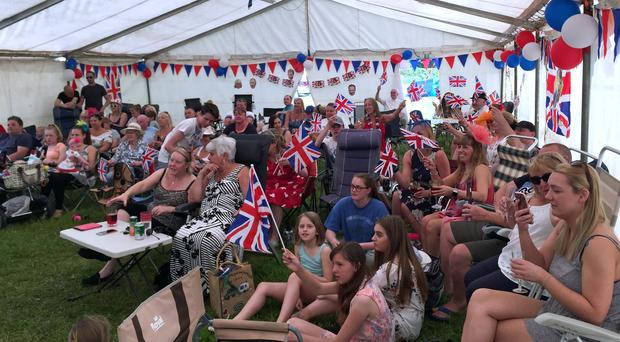 People watch the royal wedding in a marquee at the Trent Valley DA Camping and Caravanning Club in Eastwood (Josh Payne/PA)