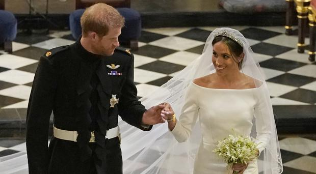 Prince Harry received a cheer when he referred to Meghan as his wife during a speech (Owen Humphreys/PA)