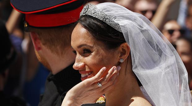Meghan Markle will now become a full-time royal (John Sibley/PA)