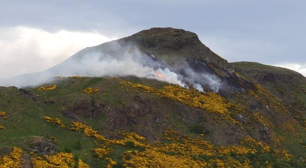 A wildfire spread across Arthur's Seat in Edinburgh on Sunday (Conor Riordan/PA)
