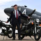 Fred Glover, 92, who served in the parachute regiment during the Second World War, with a limited edition Royal Enfield Classic 500cc Pegasus motorbike, and its inspiration (Joe Giddens/PA)