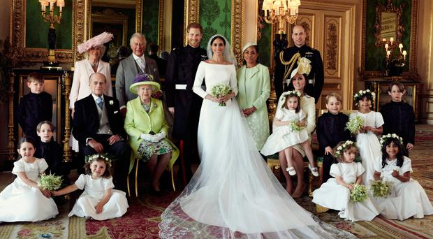 The official wedding photographs of the Duke and Duchess in The Green Drawing Room, Windsor Castle with (back row from left) Jasper Dyer, the Duchess of Cornwall, the Prince of Wales, Doria Ragland, The Duke of Cambridge; middle row: Brian Mulroney, the Duke of Edinburgh, the Queen, the Duchess of Cambridge, Princess Charlotte, Prince George, Rylan Litt and John Mulroney. Front row: Ivy Mulroney, Florence van Cutsem, Zalie Warren and Remi Litt