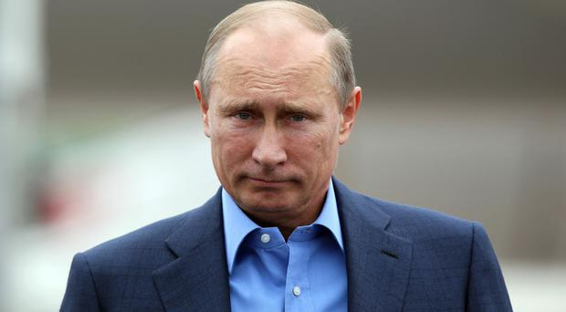 MPs have called on the Government to halt the flow of Vladimir Putin's 'dirty money' into London (Peter Muhly/PA)