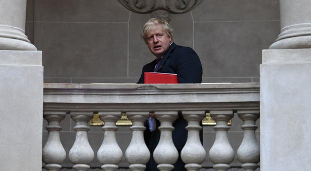 Boris Johnson arrives at a meeting of the foreign ministers of the G20 group of economic powers in Buenos Aires, Argentina (Stefan Rousseau/PA)