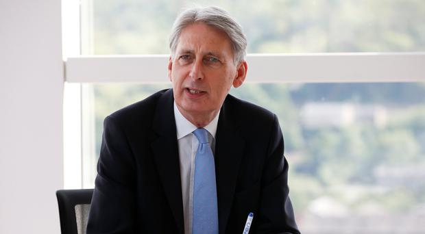 Chancellor of the Exchequer Philip Hammond during a meeting of regional leaders of the financial and professional services in Halifax (Craig Brough/PA)