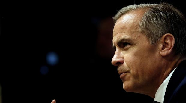 Bank of England Governor Mark Carney has come to the defence of the Monetary Policy Committee's decision on interest rates (Frank Augstein/PA)