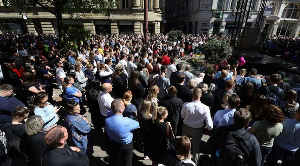 Members of the public observe a one minute silence during the Manchester Arena National Service of Commemoration (Aaron Chown/PA)