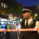 A police officer at the scene on Upper Street in Islington (Victoria Jones/PA)