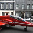 A Red Arrows jet in Downing Street