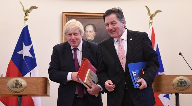 Boris Johnson and Chilean foreign minister Roberto Ampuero (Stefan Rousseau/PA)