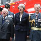 Prime Minister Theresa May stands with members of the RAF at the Number 10 reception (Jonathan Brady/PA)