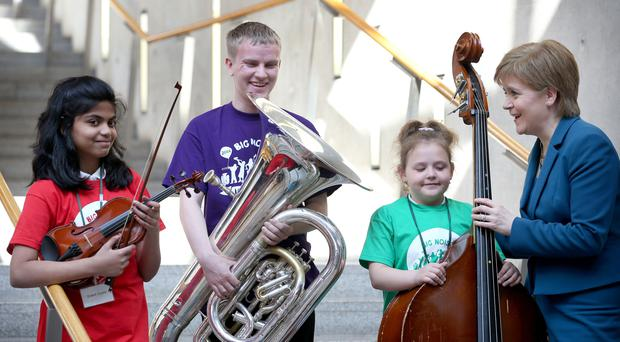 Nicola Sturgeon with young musicians from Big Noise (Jane Barlow/PA)