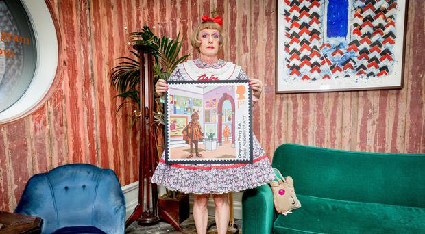 Grayson Perry holding his stamp to mark the 250th anniversary of the founding of the Royal Academy of Arts (Royal Mail/PA)