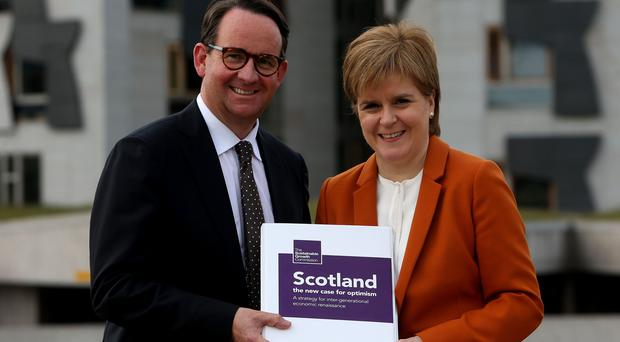 Nicola Sturgeon receives the Sustainable Growth Commission report from Andrew Wilson (Gordon Terris/The Herald/PA)