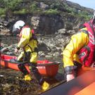 A volunteer lifeboat team reach the family (Kyle RNLI/PA)