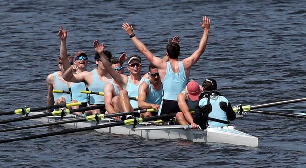 The crew of the men's eight from the University of Edinburgh celebrate beating the University of Glasgow in the annual Scottish boat race (Jane Barlow/PA)