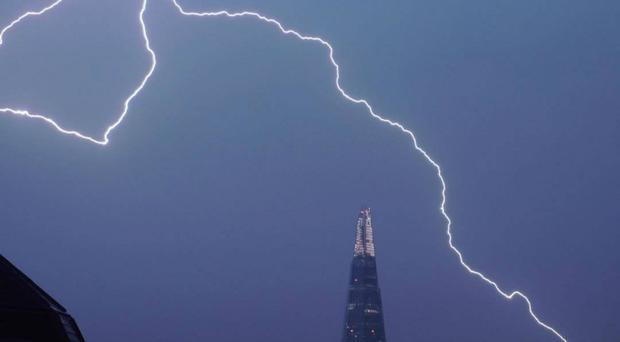 Lightning over The Shard in central London (@samueltwilkinson/PA)