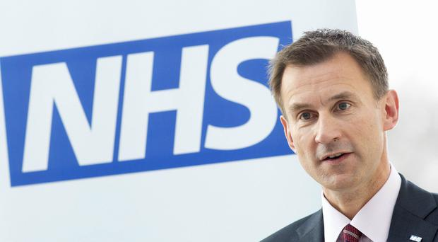 Jeremy Hunt said he is 'determined to eliminate this gap' (Neil Hall/PA)