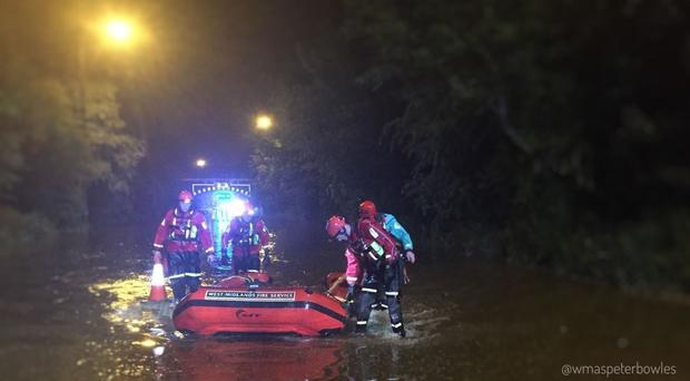 West Midlands Ambulance Service were called after a car was submerged in flood water in Walsall (Peter Bowles/West Midlands Ambulance Service/PA)