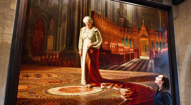 A portrait of the Queen is part of the display (John Stillwell/PA)