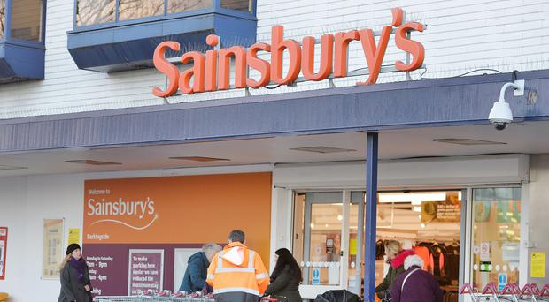 Sainsbury's is lifting basic pay but cutting other staff benefits (John Stillwell/PA)