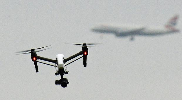 Drone users will be required to register and take a safety test (John Stillwell/PA)