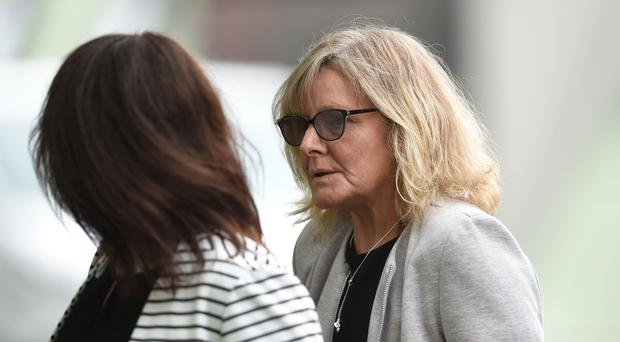 Cherise Lyons, 57, (right) of Dagenham, arrives at Basildon Crown Court (Joe Giddens/ PA)