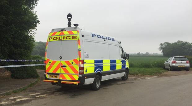 Police near the scene in Aldborough where a helicopter crashed (Henry Clare/PA)