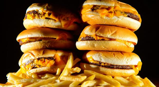 Campaigners are calling for a ban on junk food advertising before the 9pm watershed