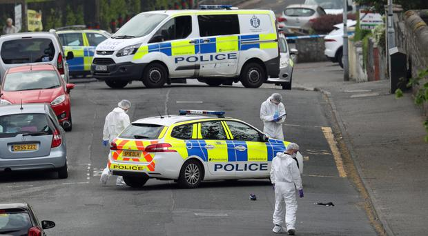 Forensic officers at the scene of an incident in Gateside Gardens, Greenock (Andrew Milligan/PA)